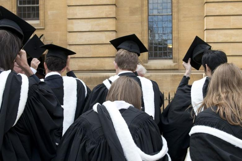 Oxford students in graduation robes